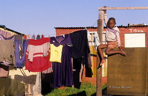 ArkImages.com - Shawn Benjamin Photography | Boy on Wall, South Africa